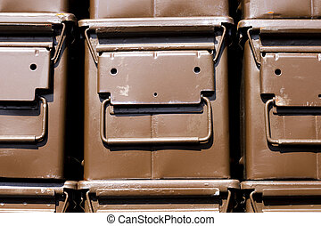 Stacked brown ammunition boxes designed for the safe...
