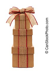 Stacked brown gift boxes with rustic burlap bow and ribbon