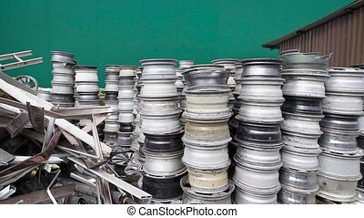 Stacked cars rims and discs on recycling storage of...