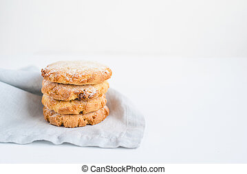 Stacked cookies on a linen napkin.