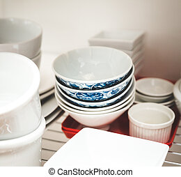 Stacked dishes in kitchen