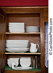 Stacked Dishes - Stacked white square dishes in kitchen...
