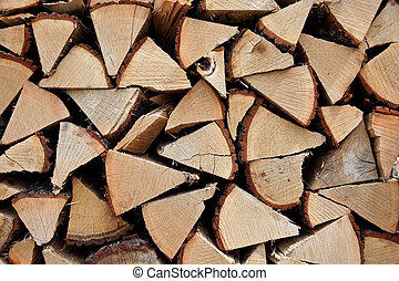 Stacked firewood on a pyre - Firewood
