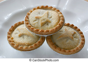 three fruit pies stacked on a plate