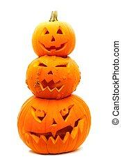 Group of three stacked Halloween Jack o Lanterns on a white background