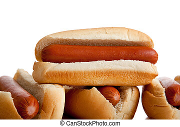 Stacked hot dogs and buns on white