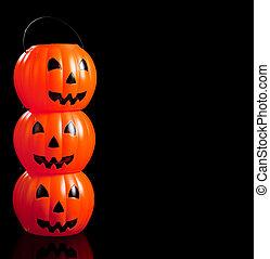 Stacked jack-o-lanterns on black