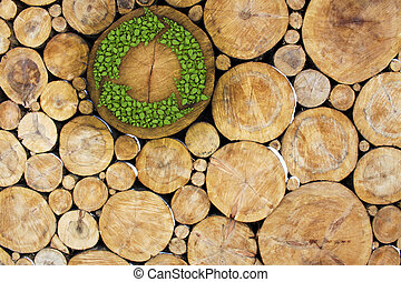 Stacked Logs with recycle symbol, concept