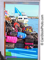 Stacked luggage and backpacks aboard of the heck a ferry ...
