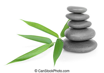 Stacked massage stones and bamboo