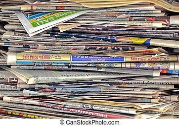 stacked newspapers - Messy pile of newspapers.