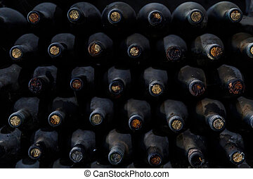 Stacked of old bottles in the cellar
