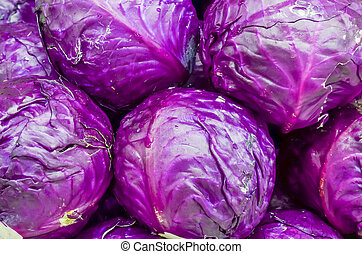 Stacked of organic red cabbage heads close-up at farmer ...