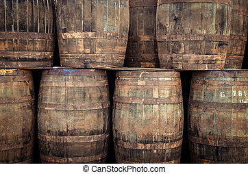 Stacked old whisky barrels - Stacked pile of old whisky ...