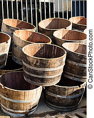 Stacked old wooden half barrels at gerden store is about to...