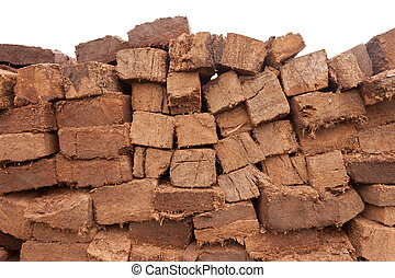 Stacked peat turf briquette cuttings background pattern -...
