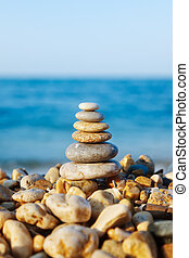 Stacked pebbles on the sea side