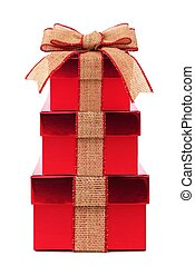 Stacked red gift boxes with rustic burlap bow and ribbon