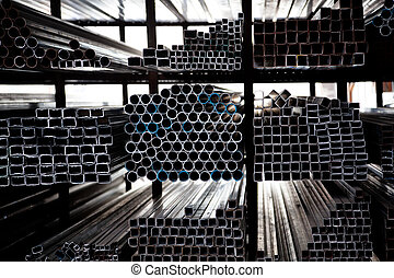 Stacked steel pipe with sunlight reflecting