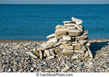 Stacked stone figure on the beach