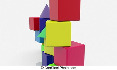 Stacked toy cubes with roofs in various colors on white