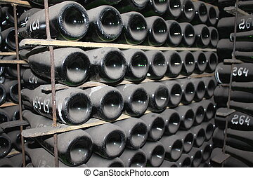 stacked up wine bottles in the cell