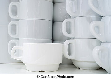 Stacked white clean cups in restaurant - Close up white...