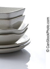 Stacked white dishes