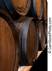 stacked wine barrels in the wine cellar