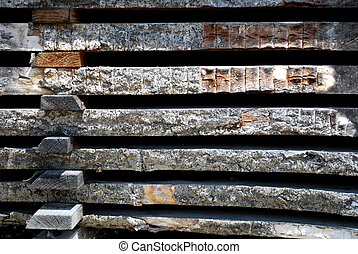 stacked wooden boards - closeup of wheathered stacked wood ...