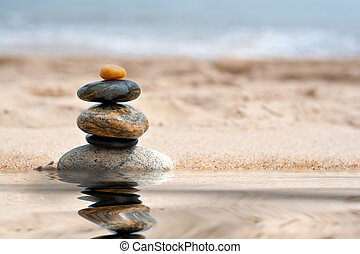 Stacked Zen Rocks Reflection - A pile of round smooth zen...