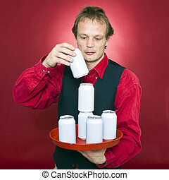 Stacking cans - A waiter stacking cans on a tray