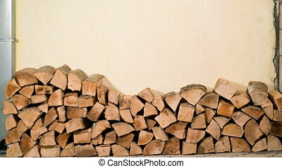 stacking of firewood along the wall, stop motion animation