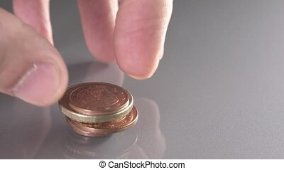 Stacking run-down euro coins with different sizes - Stacking...