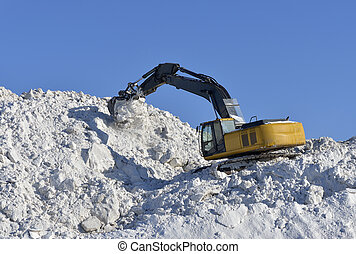 Stacking snow excavator