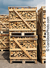 stacking wood for firewood - a large stack of wood for...
