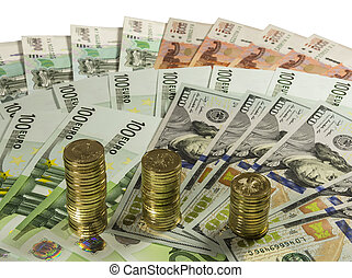 Stacks of 10 ruble coins on the background of banknotes.