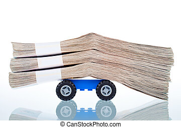 Stacks of banknotes on toy car wheels