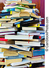stacks of books - a stack of opened and closed fully books