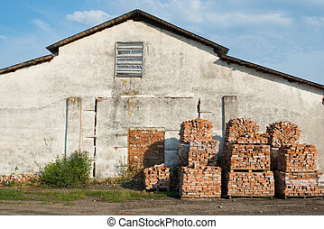 Stacks of bricks near the old house