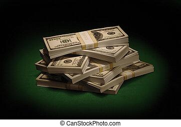 Stacks of Cash - Bundles of US $100 bills on green felt...