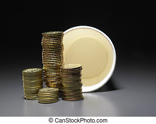 stacks of coins and paper cup