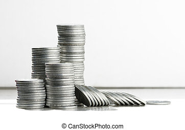 Stacks of coins - Silver coins in high stacks