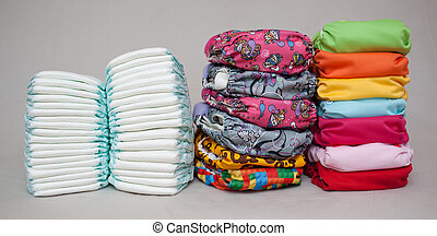 Stacks of disposable diapers and modern cloth diapers...