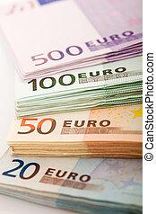 Stacks of euro banknotes - closeup