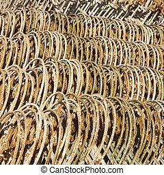Stacks of fencing together.