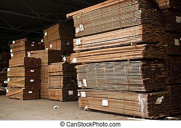 Stacks of hardwood - Tacks of a hardwood in lumber warehouse...