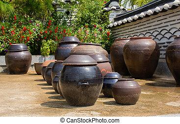 stacks of Korean Kimchi. - Heavy pots stacks of Korean...