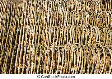Stacks of metal fencing together.