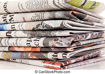 stacks of old newspapers and magazines - old newspapers and...